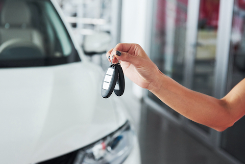 Passing car keys. Cropped closeup of a car dealer holding out car keys to the camera copyspace car dealership salon manager salesman selling buying giving owner profession purchase vehicle concept.