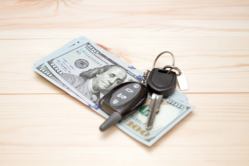 Heap of money and pen. Writer fee. Money dollars, car keys and pen