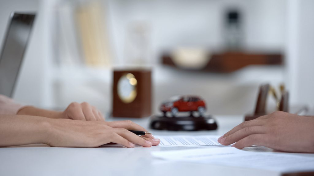 Car leasing expert telling woman about contract terms, vehicle insurance closeup